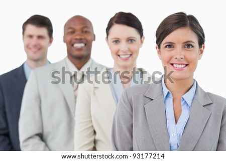 Smiling young businessteam standing against a white background
