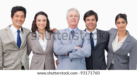 Smiling young businessteam with their mentor against a white background