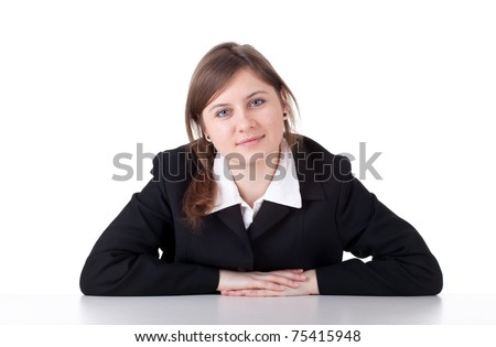 smiling young businesswoman in black suit looking at camera - stock photo