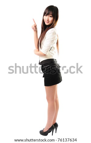 Smiling young businesswoman looking into the camera - stock photo