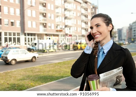 smiling, young  businesswoman on the phone, outdoor - stock photo