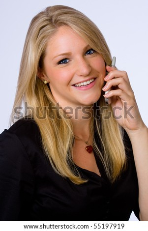 Smiling young businesswoman talks on cell phone. - stock photo