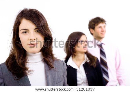 Smiling young businesswoman with team in background. Isolated on white.