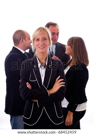 Smiling Young Businesswoman with Teamgroup on Background - stock photo