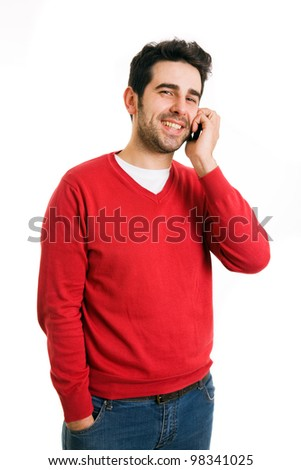 Smiling young casual man talking on the phone isolated on white background - stock photo
