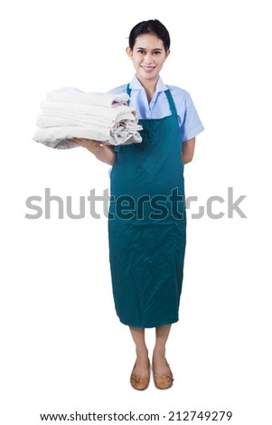 Smiling young cleaning lady holding towels isolated on white background - stock photo