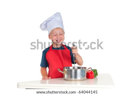 Smiling young cook stirring  food in the pan
