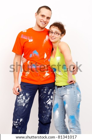Smiling young couple after home renovation in dirty clothes