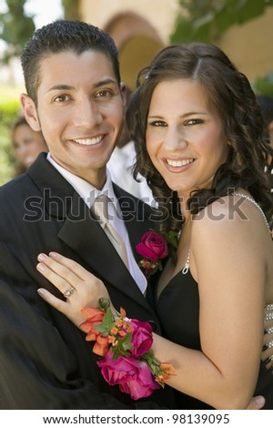 Smiling Young Couple at School Dance - stock photo