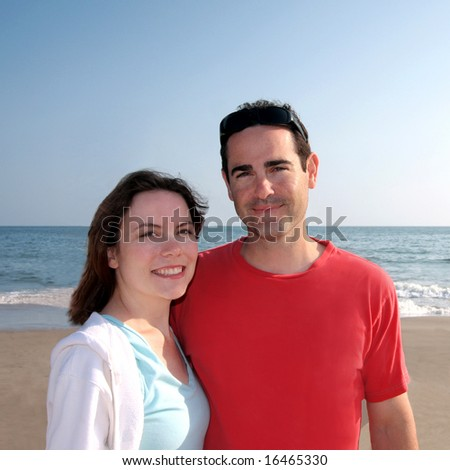 Smiling Young Couple At The Beach - stock photo