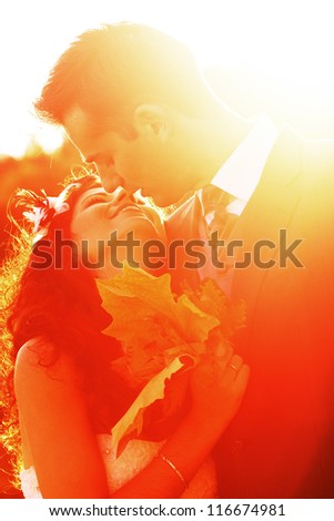 Smiling young couple kissing after their wedding - stock photo