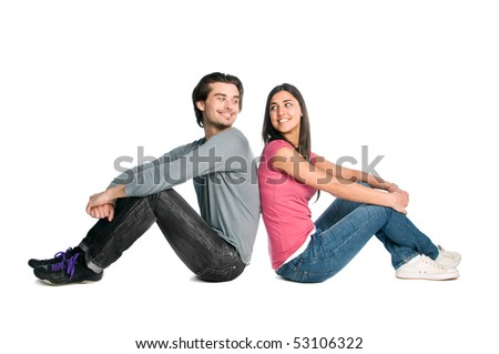 Smiling young couple looking each other with tenderness and love isolated on white background - stock photo