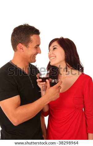 Smiling young couple socialising with glasses of red wine