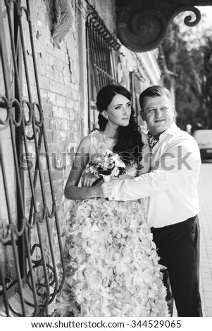 Smiling young couple standing together. Love theme - stock photo