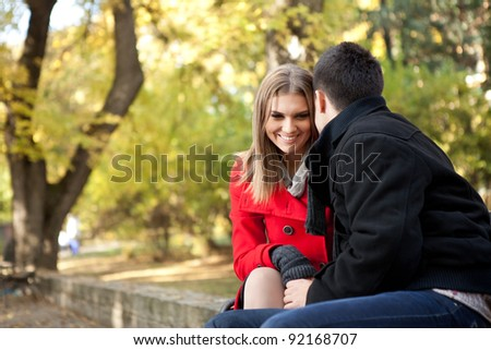smiling young couple talking, time for flirting, outdoor - stock photo