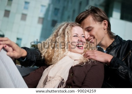 Smiling young couple together - stock photo