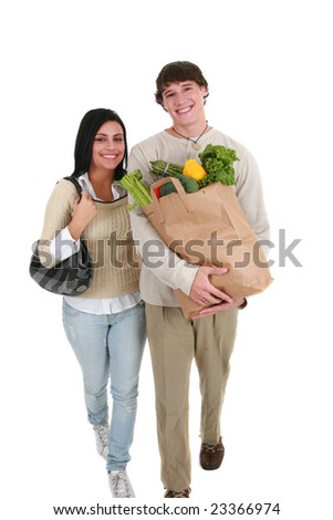 Smiling Young Couple Walking with Groceries Shopping Items - stock photo