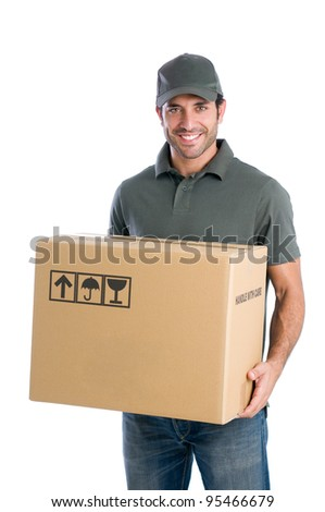 Smiling young delivery man holding and carrying a cardbox isolated on white background