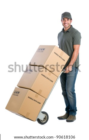 Smiling young delivery man moving boxes with dolly, isolated on white background - stock photo