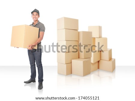 Smiling young delivery man with a lot of cardbox package - stock photo