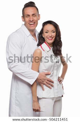 smiling young doctors in white clothes on an isolated background