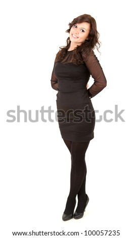 smiling young elegant business woman in black dress, full length, white background