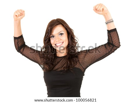 smiling young elegant teenage girl in black dress with raised fists, white background
