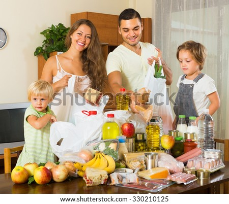 Smiling young family with kids came back from supermarket