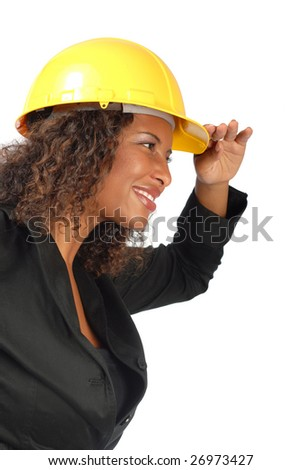 Smiling young female architect looking forward - stock photo