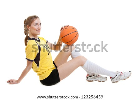 smiling young female basketball player with ball