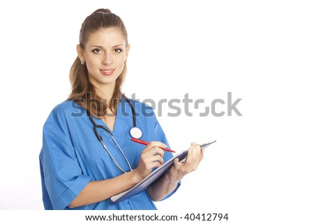 Smiling young female medical doctor standing with stethoscope and clipboard