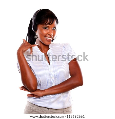 Smiling young female wearing a headphones saying call me with the hand on isolated background