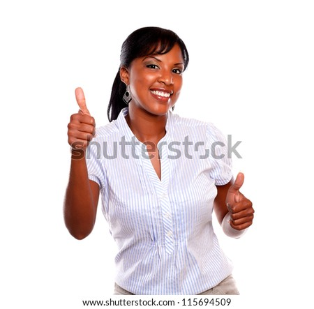 Smiling young female with a winning attitude against white background - stock photo