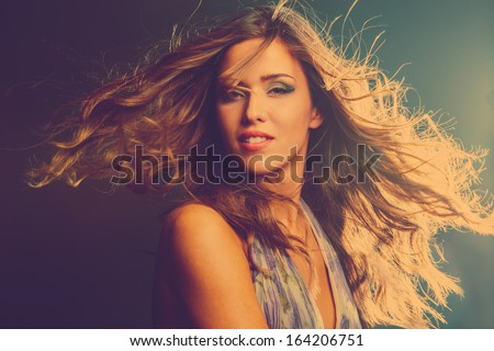 smiling young girl dancing in night club - stock photo