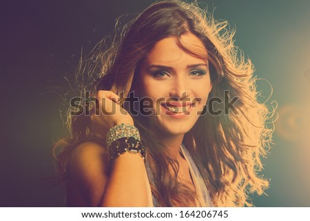 smiling young girl dancing in night club close up - stock photo