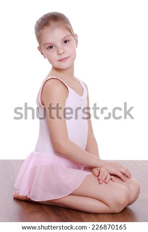 Smiling young girl doing gymnastics isolated over white - stock photo