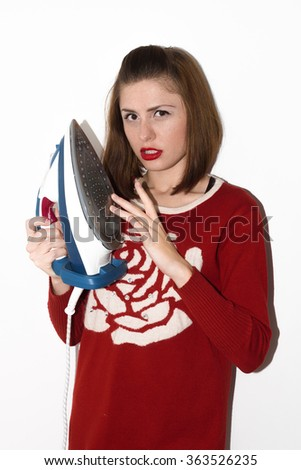 Smiling young girl ironing with iron isolated - stock photo