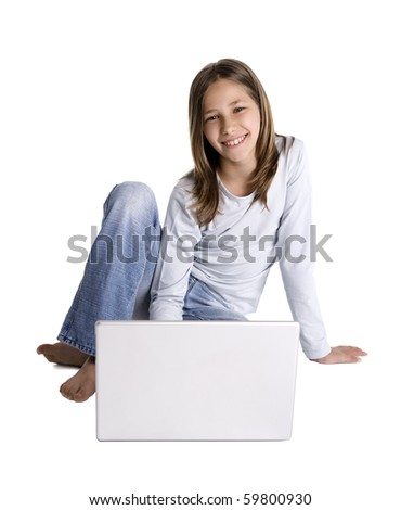 Smiling young girl on the floor with laptop computer, studio shot isolated on white background - stock photo