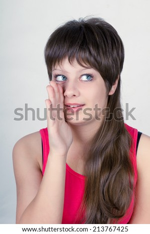 Smiling young girl speaks what is the secretly - stock photo