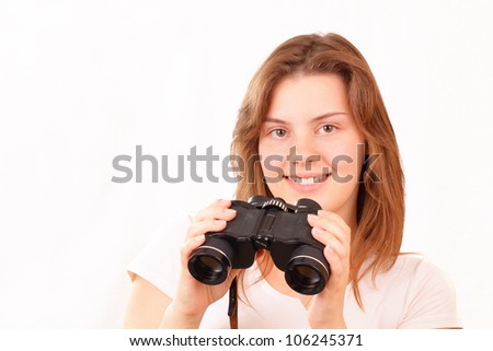 Smiling young girl with binoculars