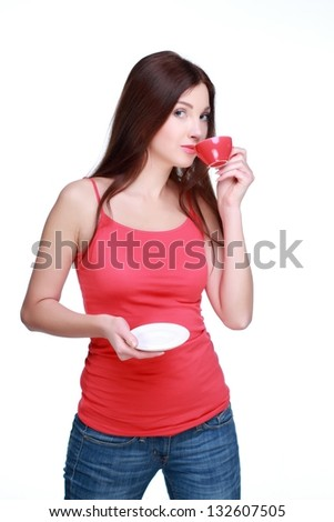 Smiling young girl with long dark hair in light clothing is drinking coffee on white background on Holiday