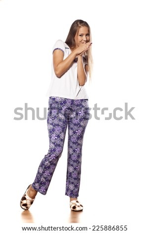 smiling young girl with long hair posing in pajamas and slippers