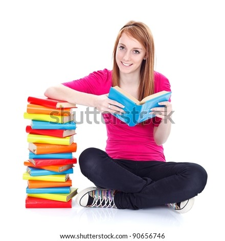 Smiling young girl with lots of books