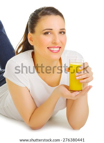 Smiling young girl with orange juice isolated - stock photo