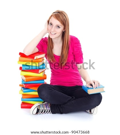 Smiling young girl with plenty of books