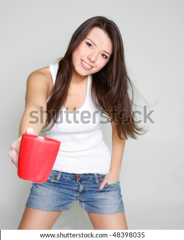 smiling young girl with red tea cup - stock photo
