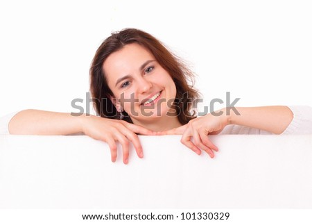 Smiling young girl with sheet of paper - stock photo