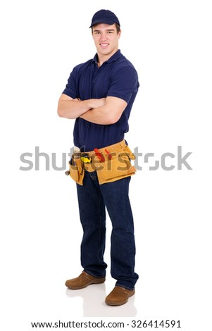 smiling young handyman with arms crossed - stock photo
