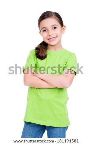 Smiling young happy girl with crossed hands in green t-shirt isolated on white background. - stock photo