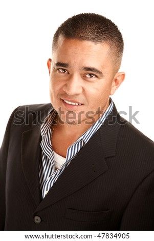 Smiling young Hispanic man in coat and striped shirt - stock photo